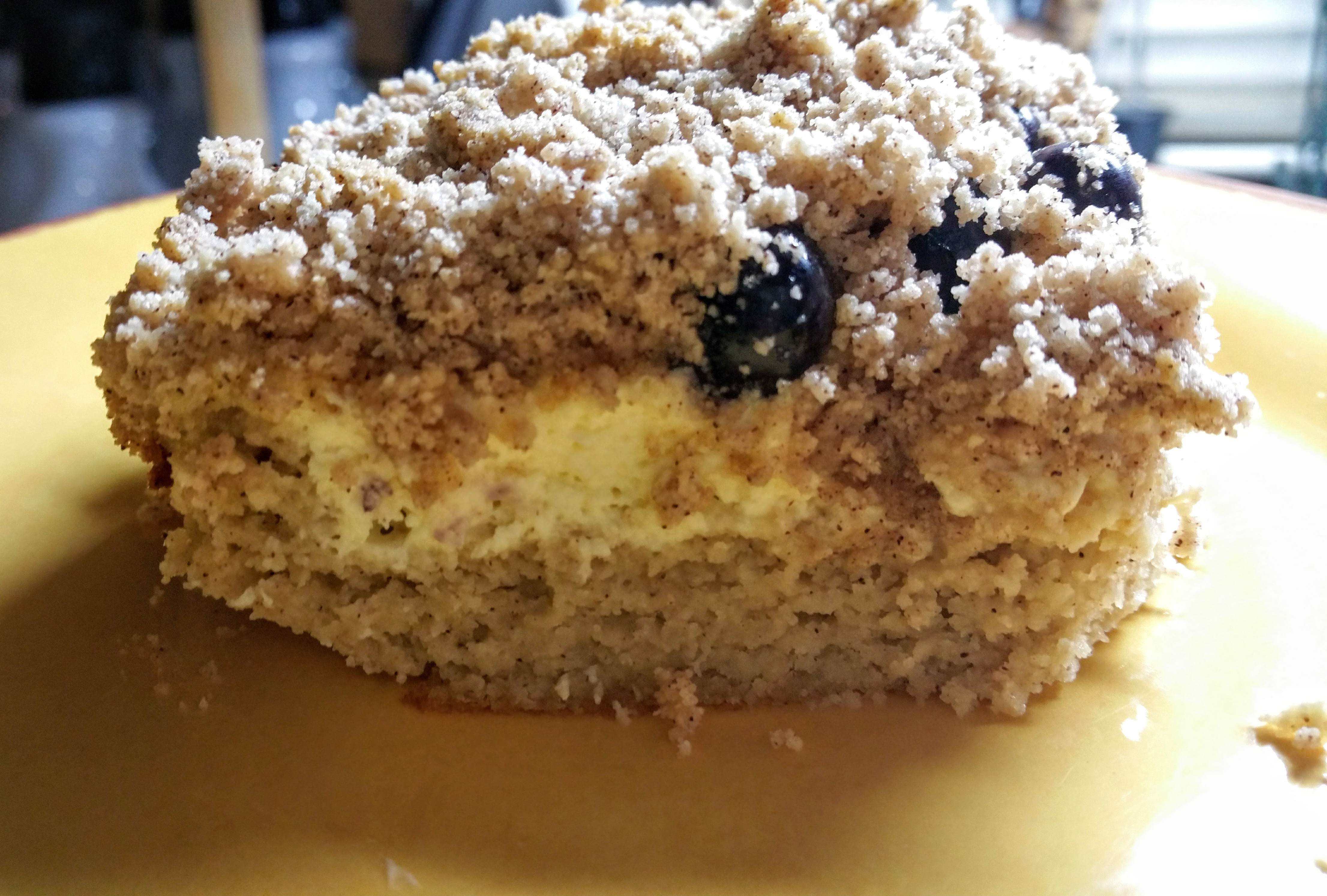 Slice of low carb blueberry cream cheese coffee cake