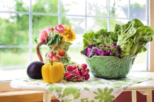 Vegetable harvest artfully arranged on table